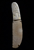 0414686 © Granger - Historical Picture ArchiveARCHAEOLOGY.    Dagger decorated with war and hunting scenes, flint blade, elephant ivory handle, recto, found at Gebel el-Arak. Egyptian Civilisation, Predynastic Period, Gerzean culture, Naqada II. Full credit: De Agostini / G. Dagli Orti / Granger, NYC -- All rights reserved.