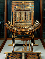 0414744 © Granger - Historical Picture ArchiveARCHAEOLOGY.    Ceremonial throne and footstool, from the Tomb of Tutankhamun, Thebes, Egypt. Egyptian civilisation, New Kingdom, Dynasty XVIII. Full credit: De Agostini / A. Jemolo / Granger, NYC -- All rights reserved.