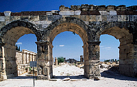 0414785 © Granger - Historical Picture ArchiveARCHAEOLOGY.    Frontinus gate or North gate and street of proconsul Julius Frontinus, Hierapolis-Pamukkale (Unesco World Heritage List, 1988), Phrygia, Turkey. Roman civilisation, 1st-3rd century. Full credit: De Agostini Picture Library / Granger, NYC -- All rights reserved.