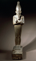 0416423 © Granger - Historical Picture ArchiveARCHAEOLOGY.    Statuette of the god Osiris with a sceptre and flail. Egyptian Civilisation, Late Period. Full credit: De Agostini / G. Dagli Orti / Granger, NYC -- All rights rese