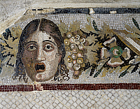 0417063 © Granger - Historical Picture ArchiveARCHAEOLOGY.    Tragic mask and festoon of flowers and fruit, mosaic from a Roman villa in Rabat, Morocco. Roman Civilisation, 1st century BC. Full credit: De Agostini / A. Dagli Orti / Granger, NYC -- All rights reserved.