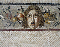 0417064 © Granger - Historical Picture ArchiveARCHAEOLOGY.    Tragic mask and festoon of flowers and fruit, mosaic from a Roman villa in Rabat, Morocco. Roman Civilisation, 1st century BC. Full credit: De Agostini / A. Dagli Orti / Granger, NYC -- All rights reserved.
