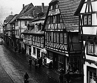 0560916 © Granger - Historical Picture ArchiveGERMANY.   Frame houses in the main street of Miltenberg in Lower Franconia. Undated picture. Full credit: Juliette Lasserre / Süddeutsche Zeitung Photo / Granger, NYC -- All rights reserved.