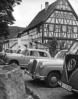 0561351 © Granger - Historical Picture ArchiveGERMANY.   German agriculture in the 50s: Village scene with half-timbered house and cars, 'the new prosperity of the agrarians'. Full credit: Kurt Schraudenbach / Süddeutsche Zeitung Photo / Granger, NYC -- All rights reserved.