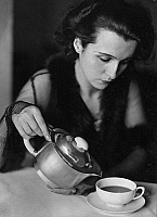 0561881 © Granger - Historical Picture ArchiveGERMANY.   A woman pours coffee from a jug into a cup. Full credit: Wanda von Debschitz-Kunowski / Süddeutsche Zeitung Photo / Granger, NYC -- All rights reserved.