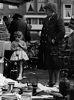 0563207 © Granger - Historical Picture ArchiveNETHERLANDS.   Girl with sunglasses and woman on the Waterlooplein flea market. Full credit: Gert Mähler / Süddeutsche Zeitung Photo / Granger, NYC -- All rights reserved.