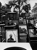 0563214 © Granger - Historical Picture ArchiveNETHERLANDS.   Mirror (Self portrait of Gert Maehler) and people on the Waterlooplein flea market. Full credit: Gert Mähler / Süddeutsche Zeitung Photo / Granger, NYC -- All rights reserved.