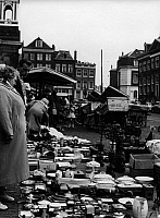 0563217 © Granger - Historical Picture ArchiveNETHERLANDS.   People and tableware on the Waterlooplein flea market. Full credit: Gert Mähler / Süddeutsche Zeitung Photo / Granger, NYC -- All rights reserved.