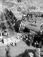 0563363 © Granger - Historical Picture ArchiveSPAIN.   Tourists and locals enjoy themselves in the amusement park that is on the Tibidabo, Barcelona's local mountain. From the amusement park that lies 512 meters high you have a wonderful view of Barcelona. Full credit: Gert Mähler / Süddeutsche Zeitung Photo / Granger, NYC -- All rights reserved.