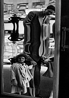 0563595 © Granger - Historical Picture ArchiveUNITED STATES OF AMERICA.   Father and daughter in front of a fun house mirror in New York. Undated picture. Full credit: Kurt Schraudenbach / Süddeutsche Zeitung Photo / Granger, NYC -- All rights reserved.
