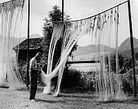 0565232 © Granger - Historical Picture ArchiveAUSTRIA.   A fisherman with his nets on Wolfgangsee. Full credit: Scherl / Süddeutsche Zeitung Photo / Granger, NYC -- All rights reserved.