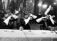 0576510 © Granger - Historical Picture ArchiveGERMANY.   Students drink at the commercium of the General Confederation of German Students in the Kroll Opera in Berlin. Full credit: Scherl / Süddeutsche Zeitung Photo / Granger, NYC -- All rights reserved.