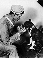0576511 © Granger - Historical Picture ArchiveGERMANY.   A 'typical German' student in the Hollywood show - in uniform, with scar and attack dog. Full credit: Süddeutsche Zeitung Photo / Granger, NYC -- All rights reserved.