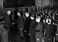 0576515 © Granger - Historical Picture ArchiveGERMANY.   The principal of the University Prof. Lothar Kreuz at the solemn commitment of new students, among them members of the Wehrmacht and wounded men of different military units in the Old Hall of the Frederick William University. Full credit: Scherl / Süddeutsche Zeitung Photo / Granger, NYC -- All rights reserved.