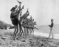 0594502 © Granger - Historical Picture ArchiveUNITED STATES OF AMERICA.   A group of women making dance exercises in front of their coach on the beach. Full credit: Scherl / Süddeutsche Zeitung Photo / Granger, NYC -- All rights reserved.