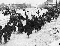 0598053 © Granger - Historical Picture ArchivePEOPLE.   Replacement Russian troops heading to the Front through the streets of the encircled city, during the siege of Leningrad. Full credit: Scherl / Süddeutsche Zeitung Photo / Granger, NYC -- All rights reserved.