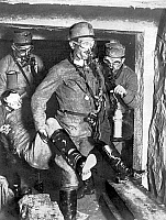 0598136 © Granger - Historical Picture ArchivePEOPLE.   Austrian-Hungarian rescue team carries a gas poisoned comrade from a submerged tunnel. Full credit: Scherl / Süddeutsche Zeitung Photo / Granger, NYC -- All rights reserved.