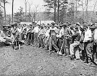 0598489 © Granger - Historical Picture ArchivePEOPLE.   A group of workers who have been assigned to a reforestation project near Luray. The work-creation program was led by officers from the US Army. On this photo Captain Leo Donovan (left) and Lieutenant William F. Train give the workers directions. The reforestation project is the first to be organized within the framework of 'Emergency Conservation