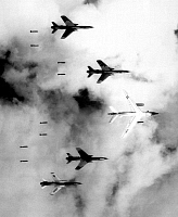 0602219 © Granger - Historical Picture ArchiveVIETNAM.   Flying with a B-66 Destroyer, USAF F-105 Thunderchiefs bomb a target through low clouds over North Vietnam (June 1966).. Full credit: Pictures from History / Granger, NYC -- All rights reserved.