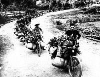 0608396 © Granger - Historical Picture ArchiveVIETNAM.   Viet Minh porters use bicycles to resupply troops with rice in the fight against the French at Dien Bien Phu, 1954. Full credit: Pictures from History / Granger, NYC -- All rights reserved.