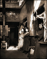 0609229 © Granger - Historical Picture ArchiveCHINA.   Three prostitutes stand outside the doors to their rooms at a brothel on Shanghai's Fuzhou Road, 1920s. Full credit: Pictures from History / Granger, NYC -- All rights reserved.