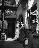 0609230 © Granger - Historical Picture ArchiveCHINA.   Three prostitutes stand outside the doors to their rooms at a brothel on Shanghai's Fuzhou Road, 1920s. Full credit: Pictures from History / Granger, NYC -- All rights reserved.