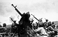 0609342 © Granger - Historical Picture ArchiveVIETNAM.   Viet Minh Division 308 unleashes a barrage of 12.7mm anti-aircraft fire at French planes, Dien Bien Phu, 1954. Full credit: Pictures from History / Granger, NYC -- All rights reserved.