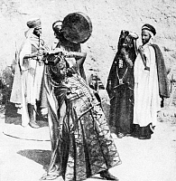 0611050 © Granger - Historical Picture ArchiveALGERIA / TUNISIA.   Ouled Nail dancing girl with musicians, c. 1920. Full credit: Pictures from History / Granger, NYC -- All rights reserved.