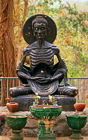 0614019 © Granger - Historical Picture ArchiveTHAILAND.   Fasting or starving Buddha figure in the forest at Wat Umong, Chiang Mai. Full credit: Pictures from History / Granger, NYC -- All rights reserved.