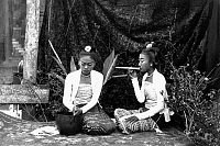 0618166 &copy; Granger - Historical Picture ArchiveBURMA / MYANMAR.   Studio portrait of two young Burmese women, one smoking a cheroot, both with faces made up with yellow <i>thanaka</i> face powder. Probably Rangoon / Yangon, c. 1895. Full credit: Pictures from History / Granger, NYC -- All rights reserved.