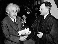 0618261 © Granger - Historical Picture ArchiveGERMANY / USA.   Albert Einstein (1879-1955) receiving his Certificate of American Citizenship from Judge Phillip Forman, 1 October 1940. Full credit: Pictures from History / Granger, NYC -- All rights reserved.