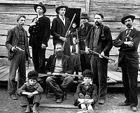0618268 © Granger - Historical Picture ArchiveUSA.   Members of the Hatfield Clan posing with their weapons, West Virginia, c. 1897, William Anderson 'Devil Anse' Hatfield seated centre. Full credit: Pictures from History / Granger, NYC -- All rights reserved.
