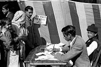 0618528 © Granger - Historical Picture ArchiveINDIA.   First Lok Sabha general election, Delhi, January 1952. A veiled Muslim woman carrying her child casts her vote at a polling station near the Jama Masjid (Friday Mosque) in Old Delhi. Full credit: Pictures from History / Granger, NYC -- All rights reserved.