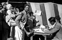 0618533 © Granger - Historical Picture ArchiveINDIA.   First Lok Sabha general election, Delhi, January 1952. A blind old man being carried towards a polling booth by his son at a polling station near the Jama Masjid (Friday Mosque) in Old Delhi. Full credit: Pictures from History / Granger, NYC -- All rights reserved.