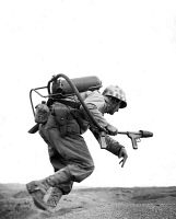 0619075 © Granger - Historical Picture ArchiveUSA.   A US marine carrying a flame-thrower sprints towards a Japanese pillbox at MotoyamaAirfield, Iwo Jima, . Full credit: Pictures from History / Granger, NYC.