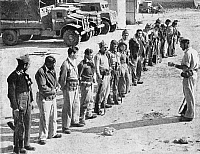 0620540 © Granger - Historical Picture ArchiveISRAEL / PALESTINE.   Soldiers of the Israeli Palmach (Negev Brigade) receive orders before participating in 'Operation Yoav', Arab-Israeli War, 1948. Full Credit: CPA Media - Pictures from History / Granger, NYC.
