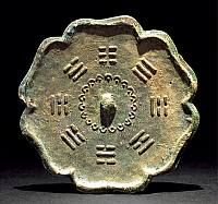 0620681 © Granger - Historical Picture ArchiveCHINA.   'Bagua' eight trigram bronze mirror, 20th century reproduction of a Tang Dynasty piece. Full Credit: CPA Media - Pictures from History / Granger, NYC.