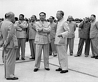 0620778 © Granger - Historical Picture ArchiveCHINA.   Liu Shaoqi, Zhou Enlai, Zhu De, Dong Biwu, He Long, Guo Moruo, Xi Zhongxun, Fu Zuoyi and Bao Erhan at Beijing's Capital Airport, Lu Xiangyou (Mao Zedong's personal photographer), 1961. Full Credit: CPA Media - Pictures from History / Granger, NYC.