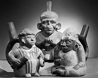 0126208 © Granger - Historical Picture ArchivePERU: MOCHE POTTERY.   From left: sitting woman, kneeling lepper, sitting hunchback. Pottery from the Moche civilization in Peru, c100-800 A.D.