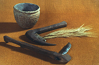 0032450 © Granger - Historical Picture ArchiveNEOLITHIC SICKLES, c3000 B.C.   Neolithic flint sickles (in modern handles) and pottery bowl from Thames, England, c3000 B.C.