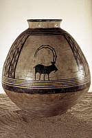 0026147 © Granger - Historical Picture ArchiveTERRACOTTA JAR.   Terracotta jar with painted ibex from Iran, c3500 B.C.