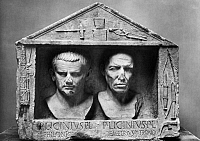 0029871 © Granger - Historical Picture ArchiveROME: GREEK FREEDMEN.   Philonicus and Demetrius, Greek freedmen of Publius Licinius. Fasces and sculptor's tools at the sides, coining implements above. Marble, early 1st century A.D. Height: 26 3/4 inches.