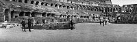0124219 © Granger - Historical Picture ArchiveROME: COLOSSEUM, c1920.   Visitors inside the Colosseum in Rome, Italy. Panoramic photograph, c1920.