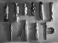 0131238 © Granger - Historical Picture ArchiveROME: IVORY ARTIFACTS.   Roman artifacts in the form of carved figures. Top row: knife handles as (left to right) gladiators with shields (2), a figure in a mantle with the head of a fox or wolf, Venus, foot with sandal, and human leg. Bottom: Hairpins (left and right), puppet and fibula in form of Venus. Ivory, circa 1st-2nd century A.D.