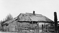 0109191 © Granger - Historical Picture ArchiveRUSSIA: LOG HOUSE, c1918.   A peasant's log house with thatched roof. Photograph, c1918.