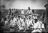 0121566 © Granger - Historical Picture ArchiveRUSSIA: CONVICTS, c1885.   Russian convicts eating lunch by a roadside in Siberia. Photographed c1885.