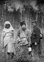 0121572 © Granger - Historical Picture ArchiveRUSSIA: CONVICTS, c1885.   Three escaped Russian convicts standing in a field in Siberia. Photographed c1885.
