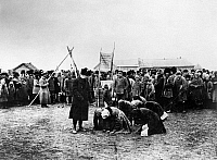 0126714 © Granger - Historical Picture ArchiveRUSSIA: FAMINE, 1922.   Hungry Russian women, victims of famine, kneeling before officials of the American Relief Association, 1922.