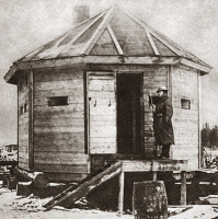 0409318 © Granger - Historical Picture ArchiveWORLD WAR I: BLOCKHOUSE.   First Class Private Arnold Butzberger guards the blockhouse which was built  by Company B, 310th Engineers and protects the South end of the Oberzerskaya in Archangel, Russia. Photograph, November 1918.