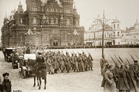 0528821 © Granger - Historical Picture ArchiveMOSCOW: RED SQUARE, c1917.   Bolshevik soldiers marching in front of the Kremlin in Moscow. A Cossack guard is on horseback is in the foreground. Photograph, c1917.